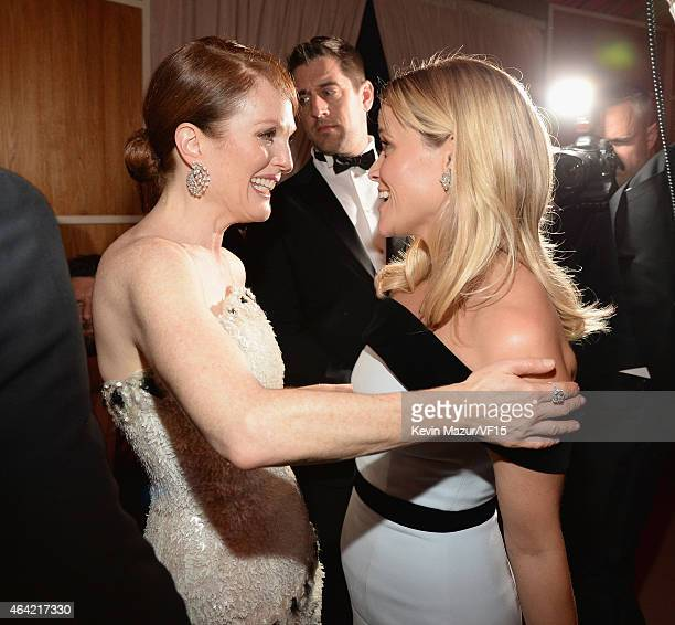 Julianne Moore and Reese Witherspoon attend the 2015 Vanity Fair Oscar Party hosted by Graydon Carter at the Wallis Annenberg Center for the...