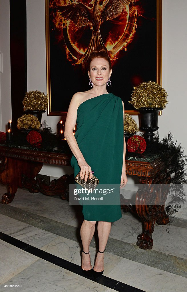 <a gi-track='captionPersonalityLinkClicked' href=/galleries/search?phrase=Julianne+Moore&family=editorial&specificpeople=171555 ng-click='$event.stopPropagation()'>Julianne Moore</a> attends Lionsgate's 'The Hunger Games: Mockingjay Part 1' party at a private villa on May 17, 2014 in Cannes, France.