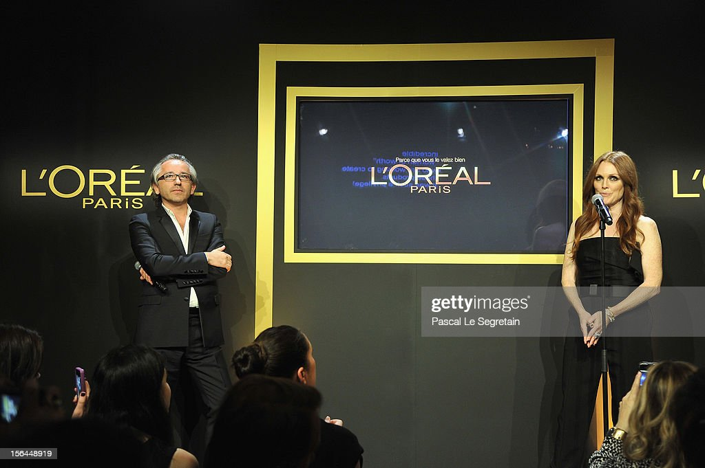 Julianne Moore gives a speech next to Cyril Chapuy during the l'Oreal new egerie presentation at Hotel D'Evreux on November 15, 2012 in Paris, France.