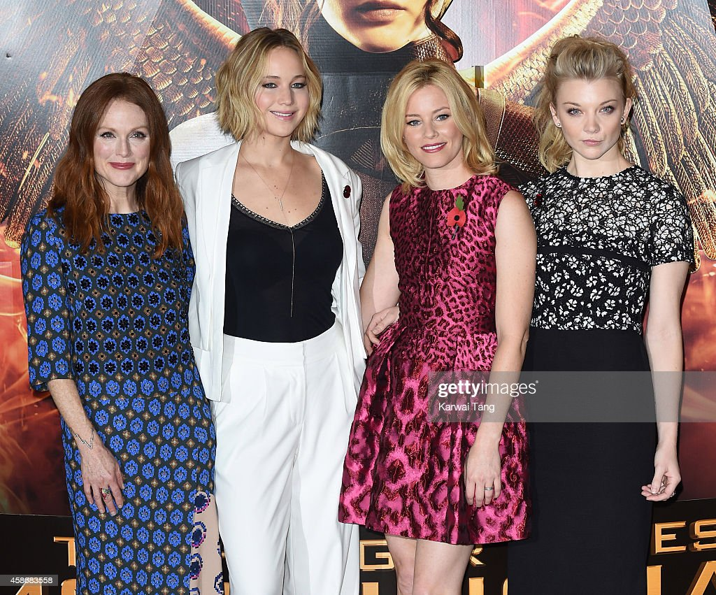 Julianne Moore Jennifer Lawrence Elizabeth Banks and Natalie Dormer attend the photocall for 'The Hunger Games Mockingjay Part 1' at Corinthia Hotel...