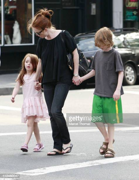 Julianne Moore sighting with her kids in the West Village where she showed son Caleb how to use an ATM machine Julianne Moore Caleb Freundlich Liv...