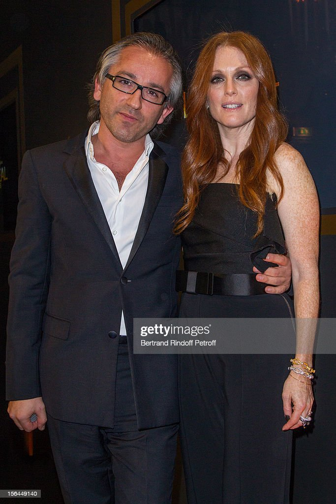 Julianne Moore, the new face of L'Oreal Paris, and Cyril Chapuy, International Managing Director of L'Oreal Paris, attend the L'Oreal New Egerie Presentation and Press Conference event at Hotel D'Evreux on November 15, 2012 in Paris, France.