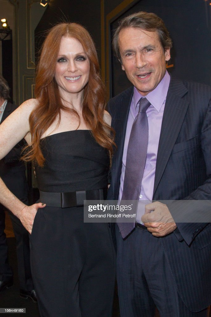 Julianne Moore, the new face of L'Oreal Paris, and Jean-Jacques Lebel, President of L'Oreal Consumer Products Division Worldwide, attend the L'Oreal New Egerie Presentation and Press Conference event at Hotel D'Evreux on November 15, 2012 in Paris, France.