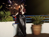 Julianne Moore wearing a Vuitton dress poses at the Hotel Martinez during the 67th Cannes film festival on May 15 2014 in CannesFrance