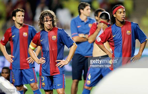 Juliano Balletti Carles Puyol Rafael Marquez and Ronaldinho of Barcelona looks dejected after the UEFA Super Cup between FC Barcelona and FC Sevilla...