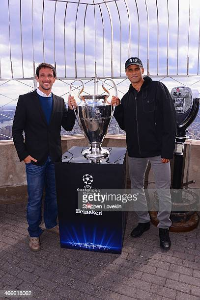 Juliano Belletti and Rivaldo pose with the UEFA Champions League trophy on top of the Empire State Building on March 17 2015 in New York City The...