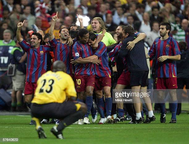 Juliano Belletti is swamped by celebrating team mates after scoring his teams winning goal during the UEFA Champions League Final between Arsenal and...