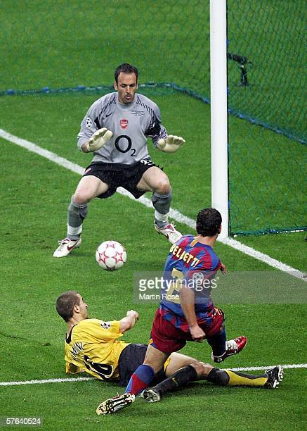 Juliano Belletti of Barcelona gets his shot in ahead of Mathieu Flamini of Arsenal to score his teams second goal during the UEFA Champions League...