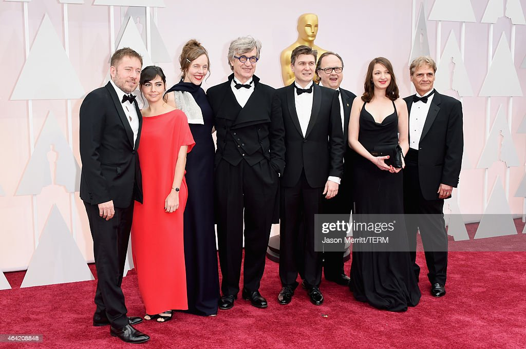Juliano Ribeiro Salgado Ivi Roberg Donata Wenders and Wim Wenders attends the 87th Annual Academy Awards at Hollywood Highland Center on February 22...