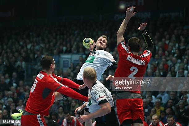 Julias Kuehn of Germany is challenged by Alexander Hermann of Austria during the international handball friendly match between Germany and Austria at...