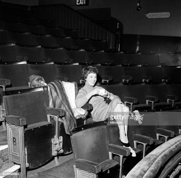 Julie Andrews watches her husband working on stage at the Lyric Theatre Hammersmith He is the stage and costume designer in William Brach's play 'A...