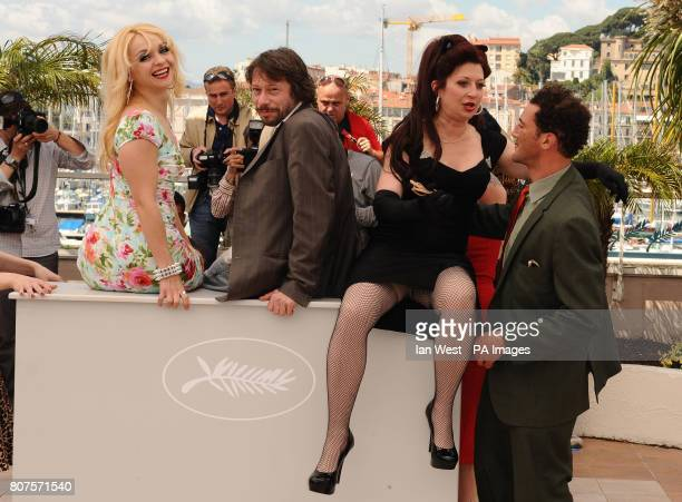 Julie Atlas Muz French director and actor Mathieu Amalric Kitten on the Keys and Roky Roulette during the photocall for the film Tournee at the...