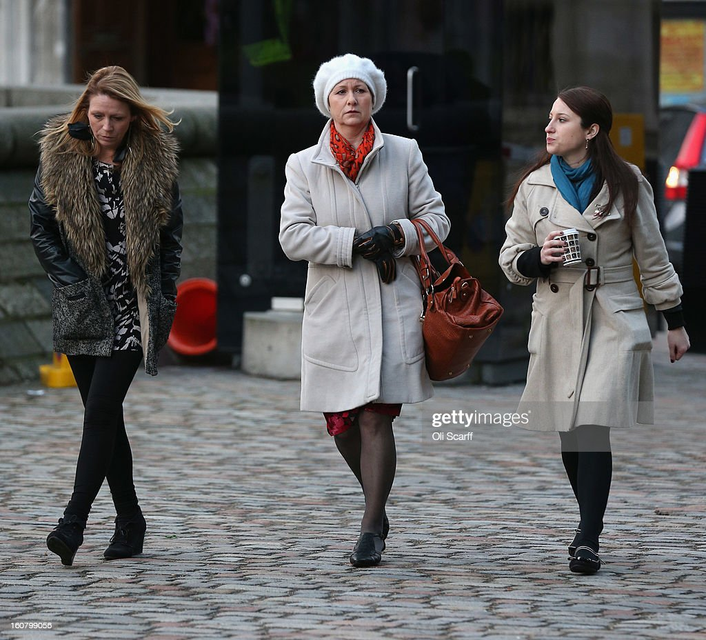 Julie Bailey (C), of the campaign group 'Cure the NHS', whose mother Bella, 86, died whilst she was a patient at Stafford General Hospital, arrives at the Queen Elizabeth II Conference Centre to read the report of the Mid Staffordshire NHS Trust Foundation Public Inquiry on February 6, 2013 in London, England. The report examines the commissioning, supervisory and regulatory bodies in the monitoring of Mid Staffordshire hospital between January 2005 and March 2009. The report will be laid before Parliament at 11:30am today and will consider the reasons why serious problems at the Trust were not identified and rectified sooner, and identify lessons to be learnt for future patient care.