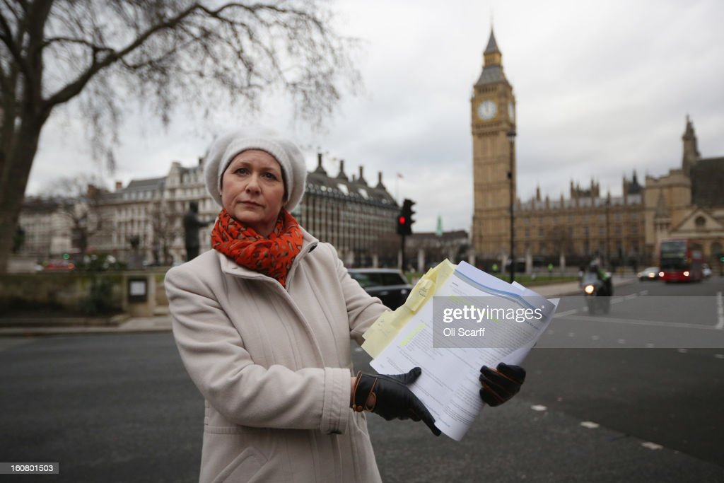 Julie Bailey, of the campaign group 'Cure the NHS', whose mother Bella, 86, died whilst she was a patient at Stafford General Hospital, poses outside the Houses of Parliament with a copy of the report of the Mid Staffordshire NHS Trust Foundation Public Inquiry on February 6, 2013 in London, England. The report examines the commissioning, supervisory and regulatory bodies in the monitoring of Mid Staffordshire hospital between January 2005 and March 2009. The report will be laid before Parliament at 11:30am today and will consider the reasons why serious problems at the Trust were not identified and rectified sooner, and identify lessons to be learnt for future patient care.