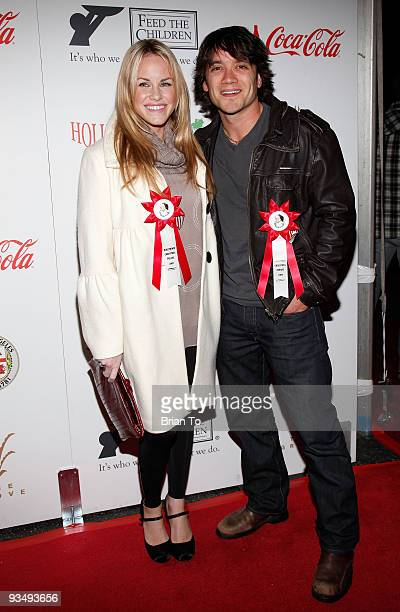 Julie Berman and Dominic Zamprogna attend the 2009 Hollywood Christmas Parade on November 29 2009 in Hollywood California