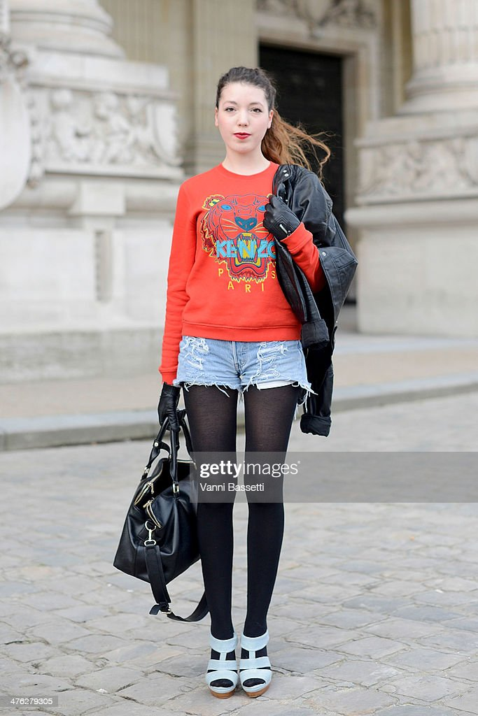 Julie Boilevin wears Kenzo sweater, H&M jacket, Levi's shorts, Andre shoes and Zara bag before Chloe show at the Grand Palais on March 2, 2014 in Paris, France.