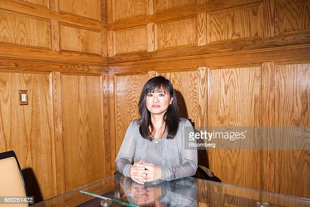 Julie Broderick former investigative supervisor at Prudential Financial Inc sits for a photograph at her attorney's office in Morristown New Jersey...
