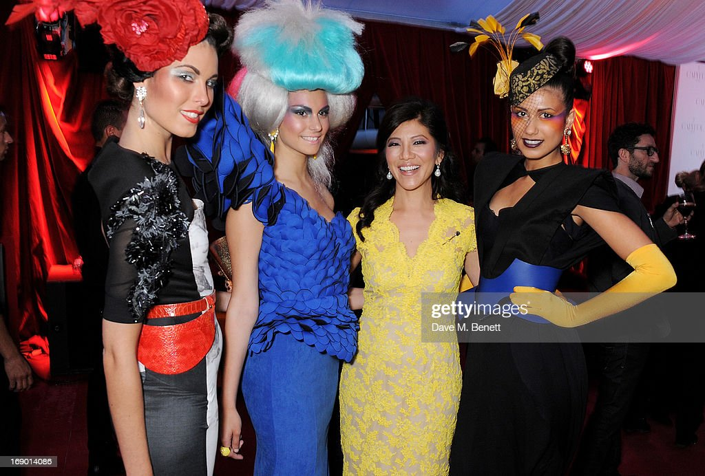 <a gi-track='captionPersonalityLinkClicked' href=/galleries/search?phrase=Julie+Chen&family=editorial&specificpeople=206213 ng-click='$event.stopPropagation()'>Julie Chen</a> (2R) and guests attend Lionsgate's The Hunger Games: Catching Fire Cannes Party at Baoli Beach sponsored by COVERGIRL on May 18, 2013 in Cannes, France.