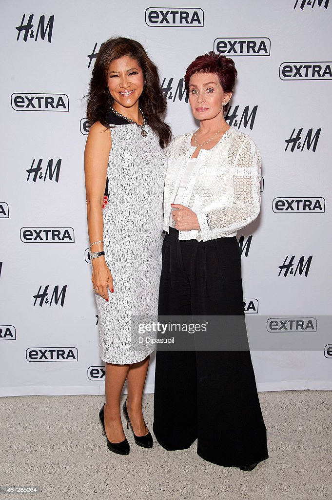 Julie Chen (L) and Sharon Osbourne visit 'Extra' at their New York studios at H&M in Times Square on September 8, 2015 in New York City.
