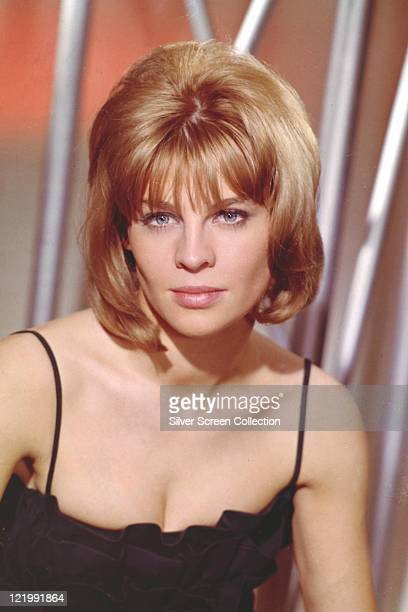 Julie Christie British actress wearing a black low cut top looking directly into the camera in a studio portrait circa 1965