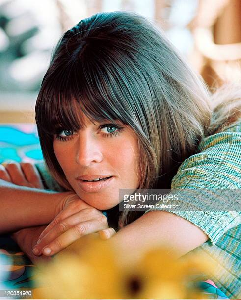 Julie Christie British actress wearing a shortsleeved turquoise knitted top circa 1965