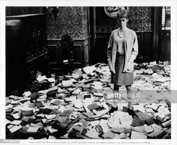 Julie Christie stands among torn books in a scene from the film Fahrenheit 451' 1966