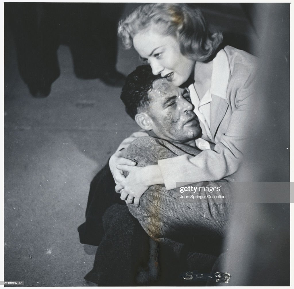 Julie comforts a wounded Stoker in a scene from the 1949 film The SetUp