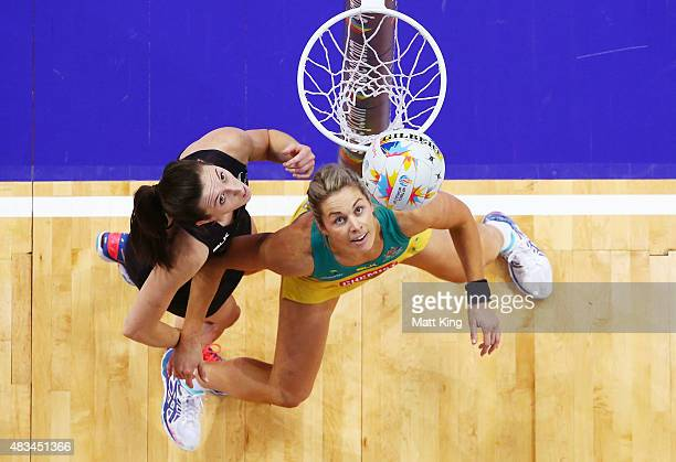 Julie Corletto of the Diamonds and Bailey Mes of New Zealand watch the ball during the 2015 Netball World Cup match between Australia and New Zealand...