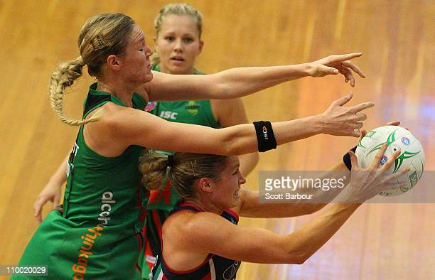 Julie Corletto of the Vixens catches the ball inder pressure from Caitlin Bassett of the Fever during the round five ANZ Championship match between...
