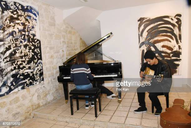 Julie Cormier at piano and Jonathan Velasquez performs on the guitar during the Concert at Galerie Rue Hus as part of Larry Clark Photos Paintings...