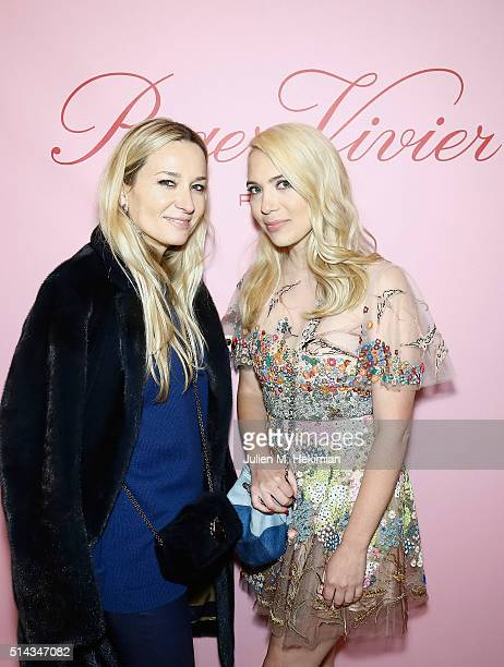 Julie de Libran and Camille Seydoux attend the Roger Vivier Prismick Denim Party at Rue Du Faubourg SaintHonoré on March 7 2016 in Paris France