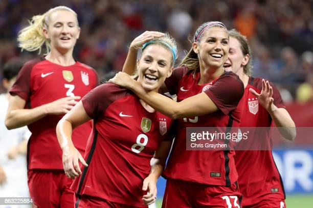 Julie Ertz of the USA celebrates after scoring a goal with Alex Morgan of the USA against the Korea Republic at the MercedesBenz Superdome on October...