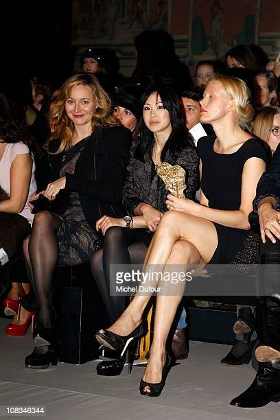 Julie Ferrier Linh Dan Pham and Anna Sherbinina attend the Elie Saab show as part of the Paris Haute Couture Fashion Week Spring/Summer 2011 at...