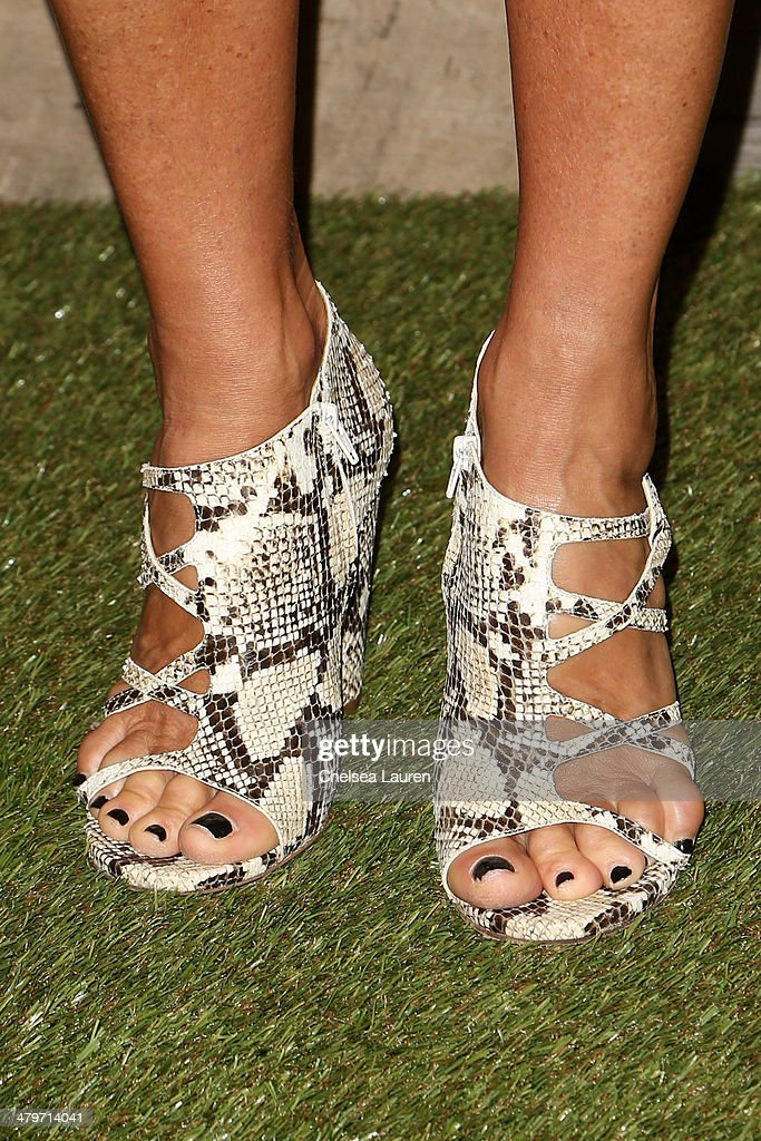 Julie Gilhart (shoe detail) attends H&M Conscious Exclusive Dinner at Eveleigh on March 19, 2014 in West Hollywood, California.