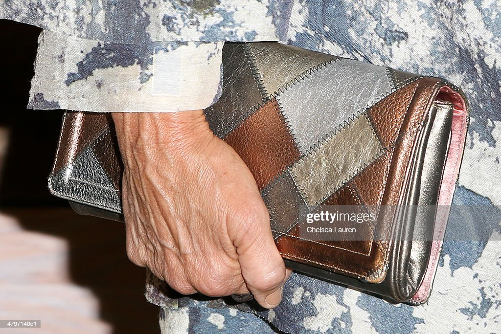 Julie Gilhart (clutch detail) attends H&M Conscious Exclusive Dinner at Eveleigh on March 19, 2014 in West Hollywood, California.