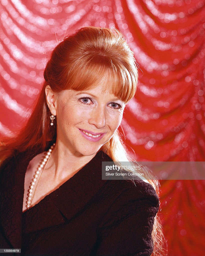 <a gi-track='captionPersonalityLinkClicked' href=/galleries/search?phrase=Julie+Harris+-+Actress&family=editorial&specificpeople=14645339 ng-click='$event.stopPropagation()'>Julie Harris</a>, US actress, wearing a blackv-neck top with a pearl necklace in a studio portrait, against a red background, circa 1960.