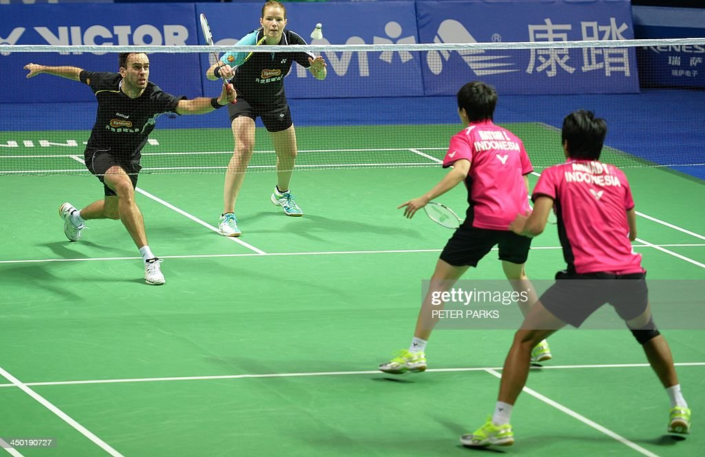 Julie Houmann (2nd-L) and Anders Kristiansen (L) of Denmark play Liliyana Natsir (2nd-R) and Tontowi Ahmad (R) of Indonesia in the mixed doubles final at the China Open badminton tournament in Shanghai on November 17, 2013. The Indonesians won 21-10, 5-21, 21-17. AFP PHOTO/Peter PARKS