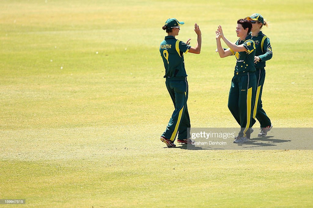 Julie Hunter of Australia (L) celebrates with teammates after she caught out Lucy Doolan of New Zealand during the Women's International Twenty20 match between the Australian Southern Stars and New Zealand at Junction Oval on January 24, 2013 in Melbourne, Australia.