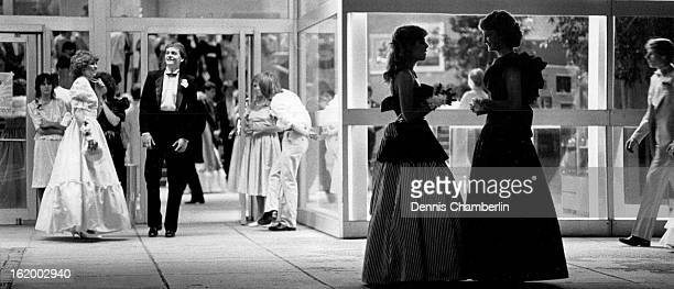 MAY 12 1984 MAY 13 1984 Julie Jacmeyer Lori Herbet talk outside the DCPA where Columbine High School prom was held
