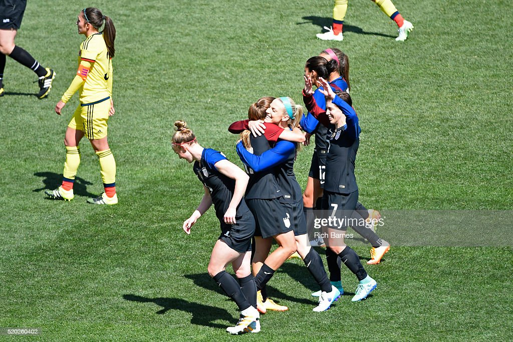 Julie Johnston #8 of the United States celebrates her goal with teammate Tobin Heath #17 against Colombia during the first half at Talen Energy Stadium on April 10, 2016 in Chester, Pennsylvania.