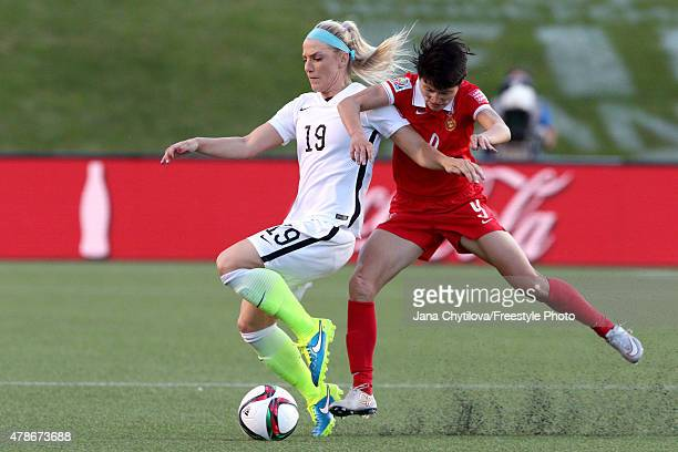 Julie Johnston of the United States competes for the ball in the first half with Wang Shanshan of China in the FIFA Women's World Cup 2015 Quarter...