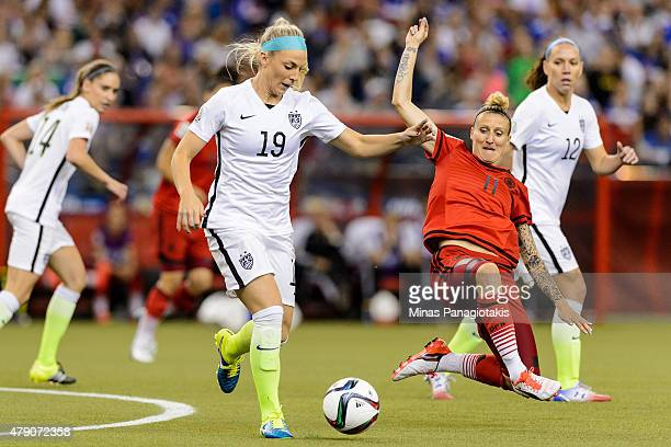 Julie Johnston of the United States moves the ball against Anja Mittag of Germany in the first half in the FIFA Women's World Cup 2015 SemiFinal...