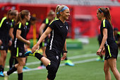 Julie Johnston of the United States of America stretches during a training session prior to the FIFA Women's World Cup Canada 2015 Final between...
