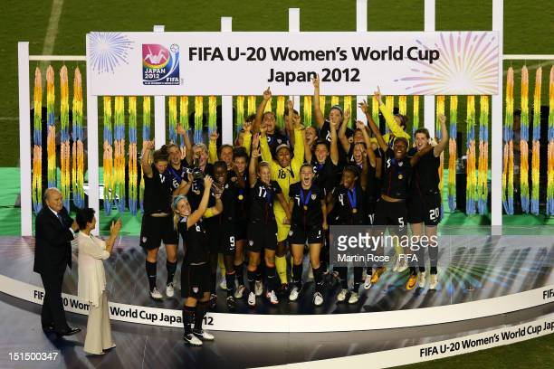 Julie Johnston of USA lifts the trophy after winning the FIFA U20 Women's World Cup Japan 2012 Final match between USA and Germany at National...