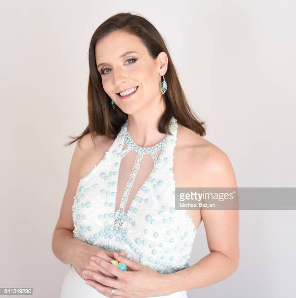 Julie Lake wearing a Dalia Mcphee dress and Sterling Forever earrings at TAP The Artists Project Style House on August 31 2017 in Los Angeles...