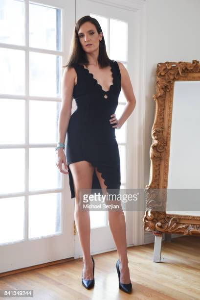Julie Lake wearing a Dalia Mcphee dress and Xehar jewelry at TAP The Artists Project Style House on August 31 2017 in Los Angeles California