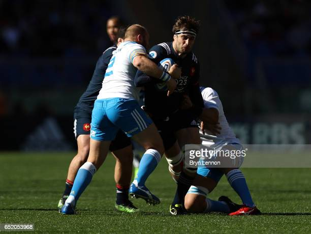 Julie Le Devedec of France is tackled by Leonardo Ghiraldini of Italy during the RBS Six Nations match between Italy and France at Stadio Olimpico on...