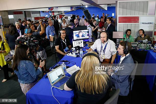 Julie Mason sits down with Politico reporters Glenn Thrush and Jake Sherman while recording an episode of 'The Press Pool' at Quicken Loans Arena on...