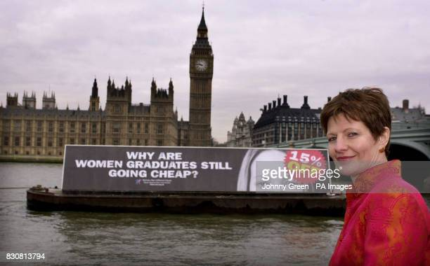 Julie Mellor Chair of the Equal Opportunities Commission stands beside a barge with the slogan 'Why are women graduates still going cheap' and a...