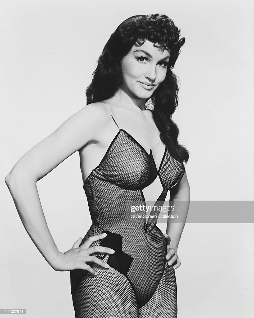 Julie Newmar, US actress, dancer and singer, wearing a fishnet body stocking in a publicity portrait issued for the film, 'Li'l Abner', USA, 1959. The musical, directed by Melvin Frank (1913-1988), starred Newmar as 'Stupefyin' Jones'.